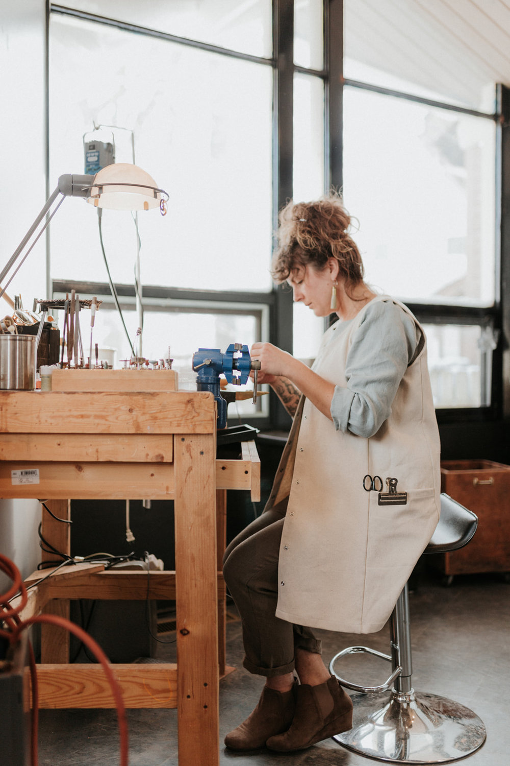 """""""It is important to have pockets for stashing frequently used tools and my phone which is constantly playing one podcast or another. I also don my apron as soon as I sit down at the bench."""" -"""