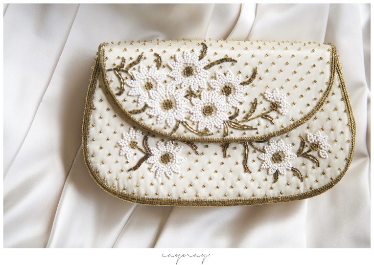 Brides purse for the day. Bedded details with gold and white.