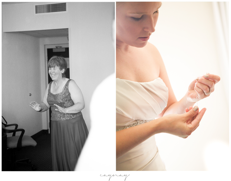 Mom seeing bride for first time. Bride putting on jewelry at hotel.