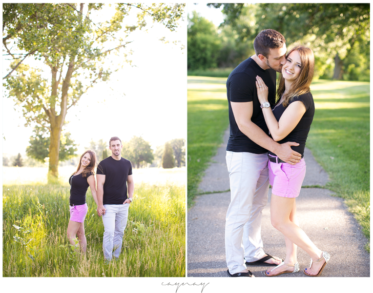 madison wisconsin natural light engagement session. pine trees. couple. purple shorts. black shirts. summer and sunshine. golf course engagement session in stoughton wisconsin