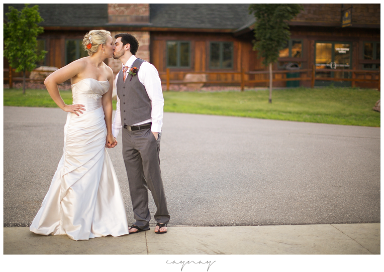 Bridal portraits in natural light. Granite peak wedding reception. Rib Mountain wedding. June Wedding. Wausau Wisconsin. Wisconsin Wedding. Natural light image. Laughter. Oyster colored satin wedding gown with beaded detail and pleats. Groom in gray suit with orange tie and white shirt.