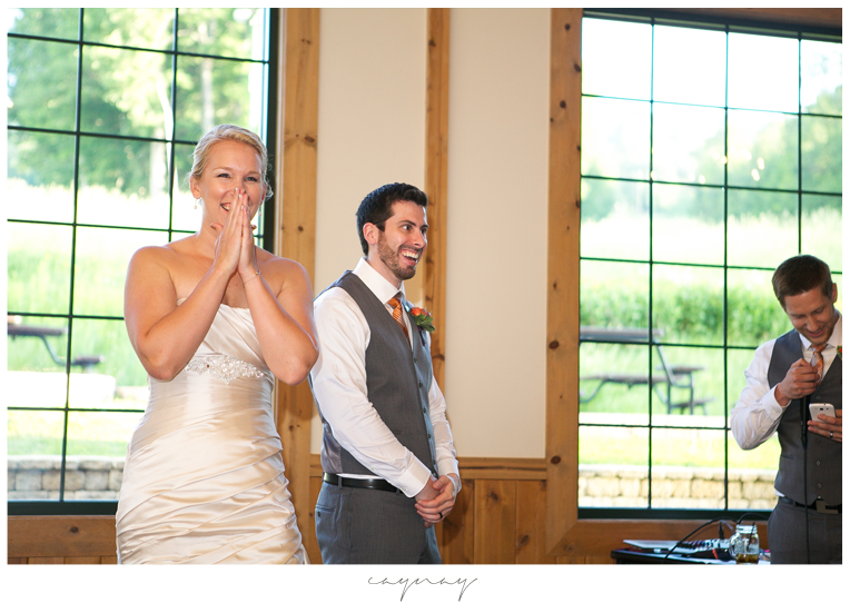 Bridal portrait during speeches. Natural light image. Laughter. Oyster colored satin wedding gown with beaded detail and pleats.