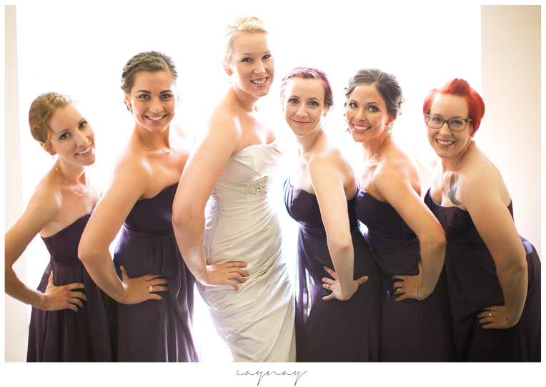 Bridal party portraits in front of window. Natural light portraiture.