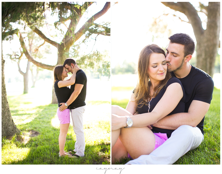 madison wisconsin natural light engagement session. pine trees. couple. purple shorts. black shirts. summer and sunshine.
