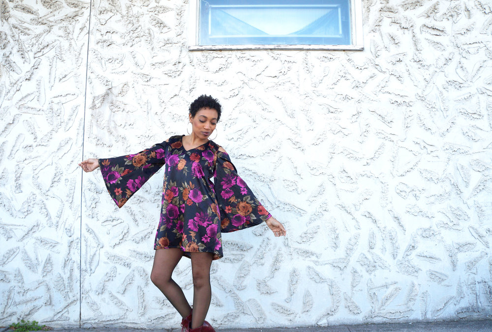 Andrea Fenise Memphis Fashion Blogger outfit of the day in a floral peaseant dress