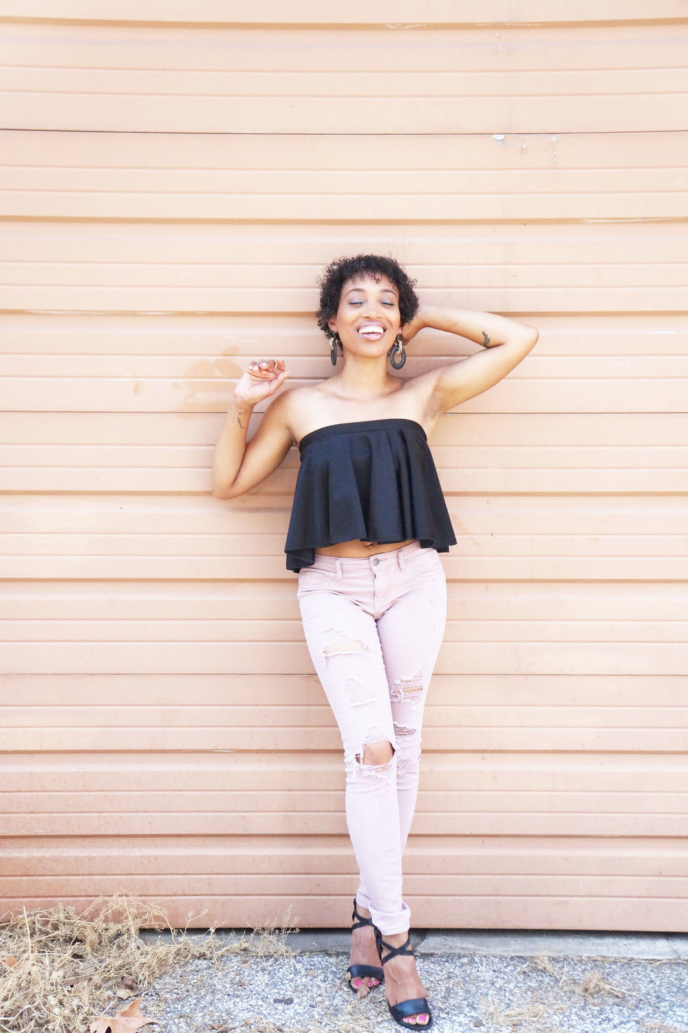 Andrea Fenise Memphis Fashion Blogger styles a peplum top
