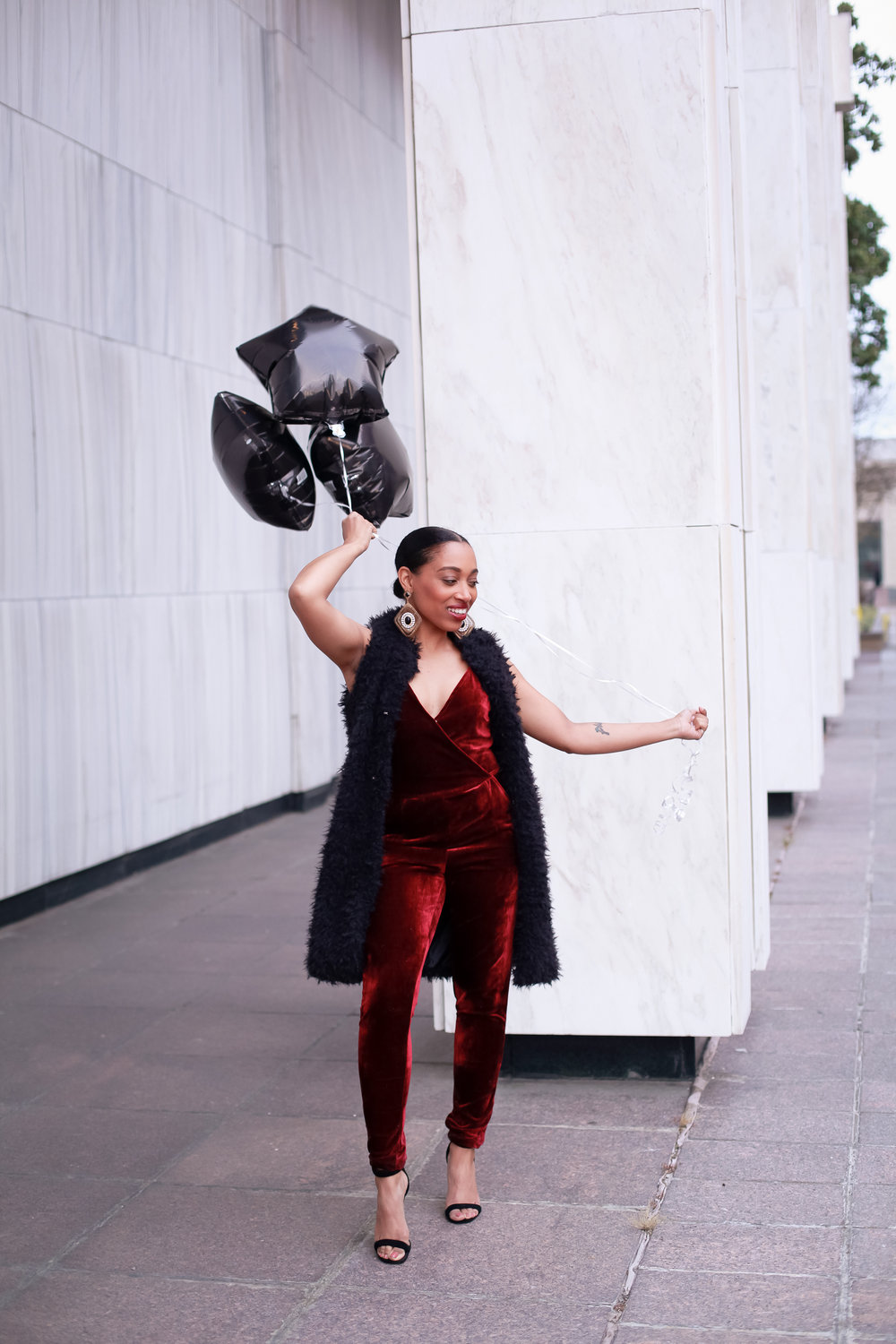 Andrea Fenise Memphis Fashion Blogger shares an outfit inspiration wearing a faux fur vest and velvet romper