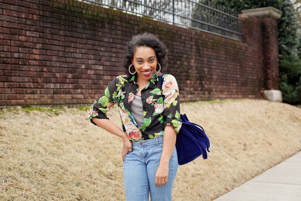 Andrea Fenise Memphis Fashion Blogger shares a floral top and wide leg jumpsuit look with blue satchel