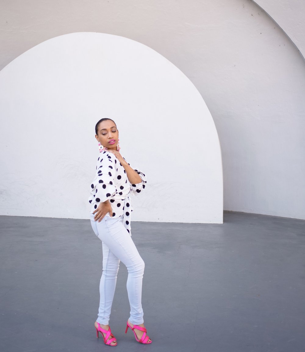 Andrea Fenise Memphis Fashion Blogger shares outfit post with polka dots and pink accessories