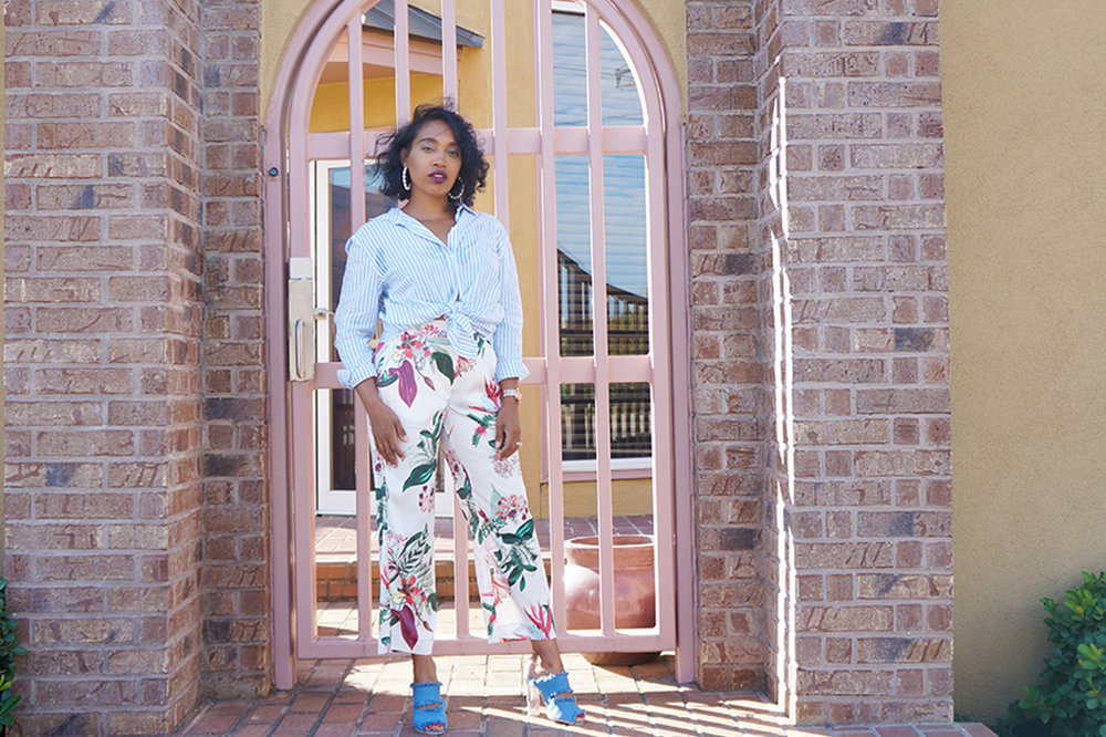 Andrea Fenise Memphis Fashion Blogger shares summers end style story with floral pants and striped blouse