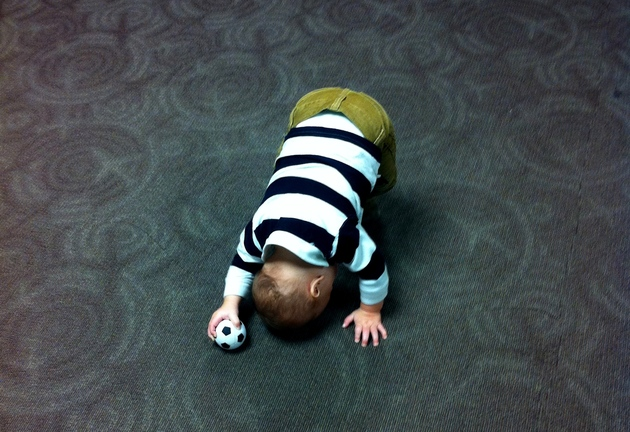 downward-dog-baby-in-airport.jpg
