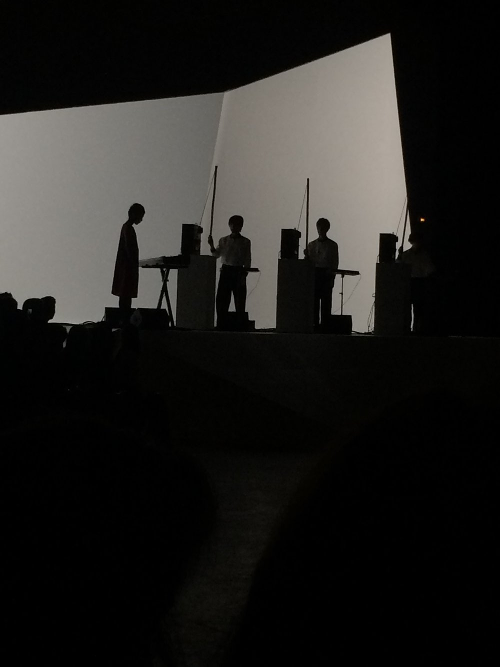 Dramatic silhouettes - the orchestra at Issey Miyake