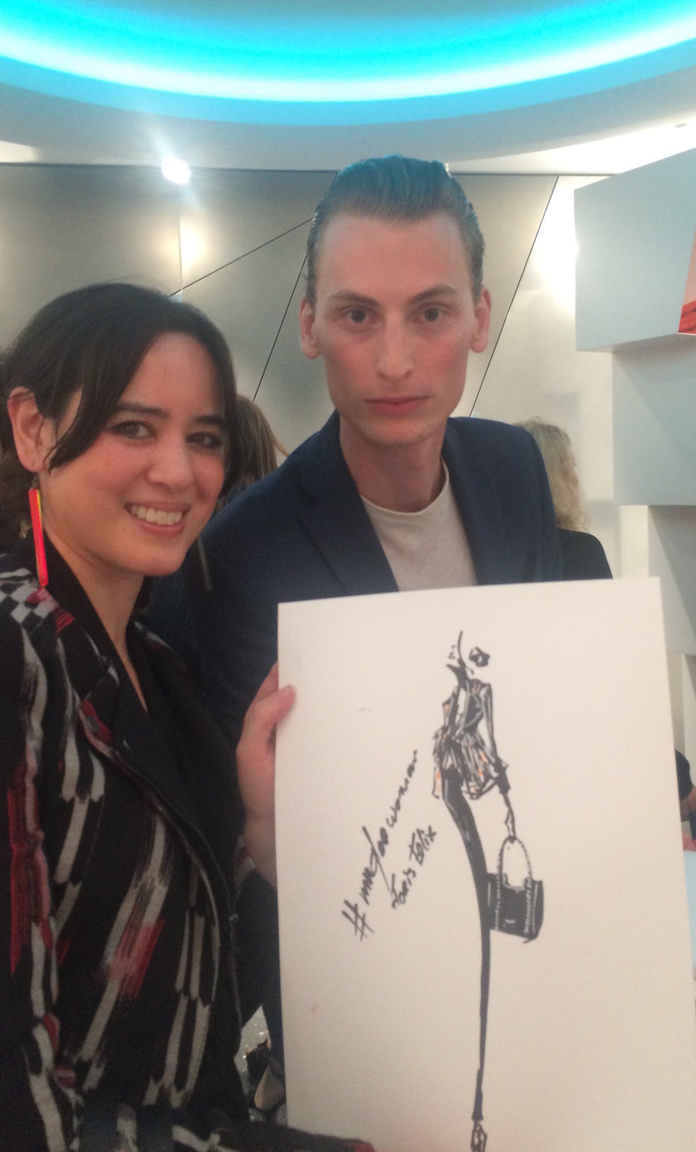Me (left) holding my portrait by artist Felix Floris (right) at Mugler