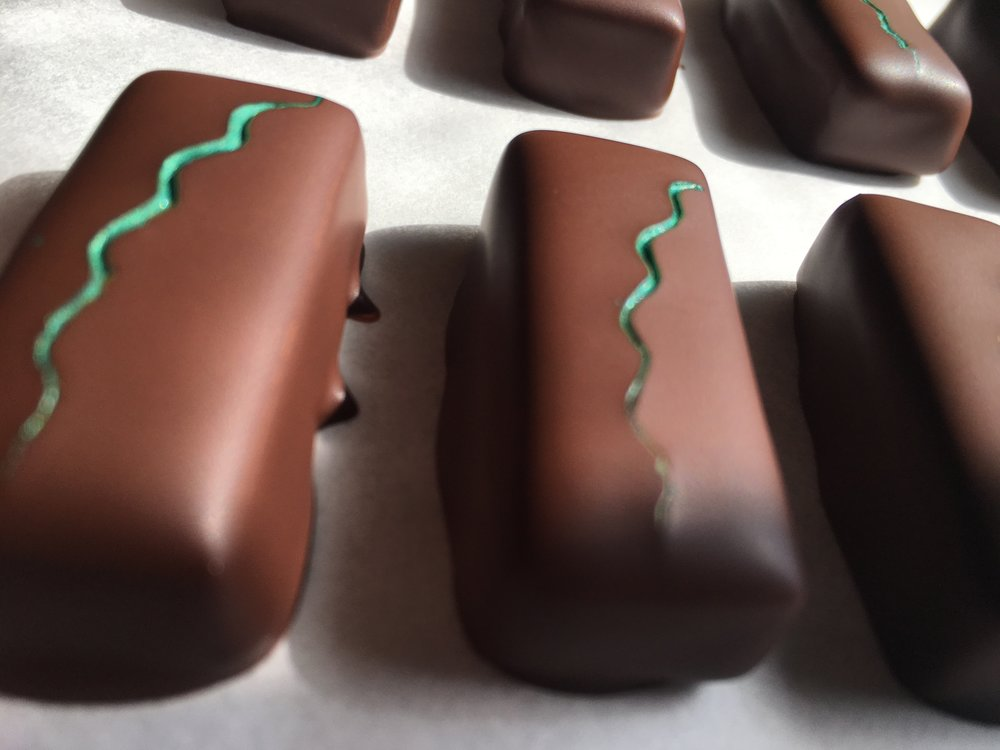 We combine dark chocolate ganache with shot of St. George Spirits' Absinthe Verte to create a complex confection with subtle anise and fennel flavors.