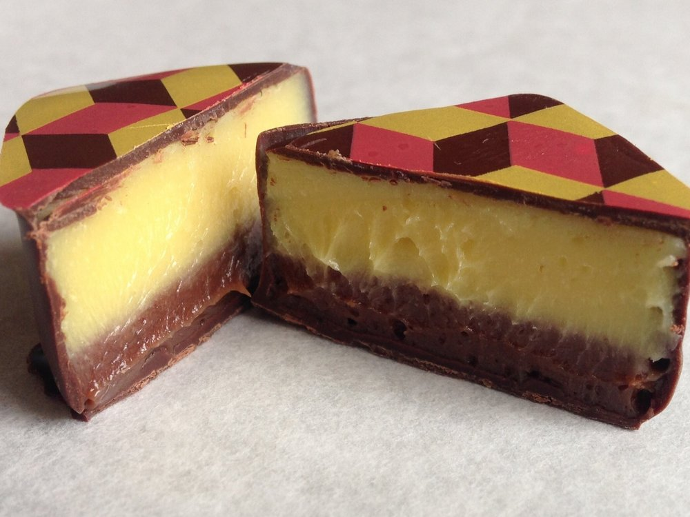 We layer milk chocolate and vanilla ganache with white chocolate and passionfruit ganache for a tart, sweet treat.