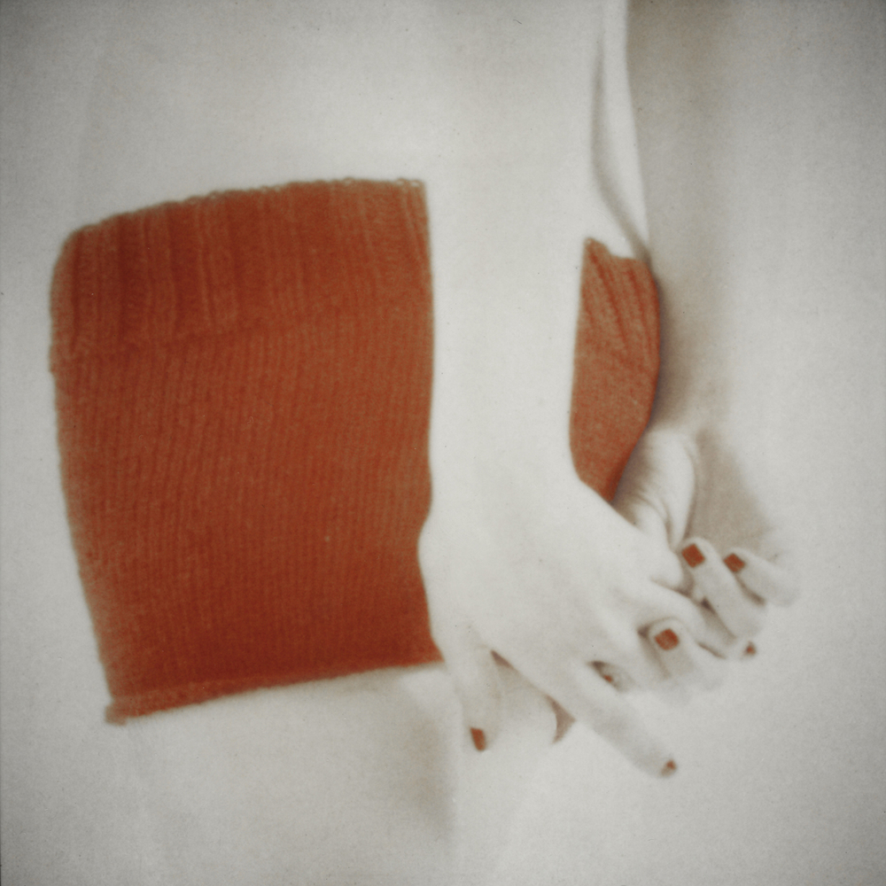 Orange Knit with Clasped Hands