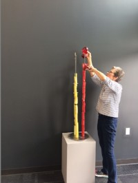 - Artist Rebecca Tomlin getting her sculpture ready.
