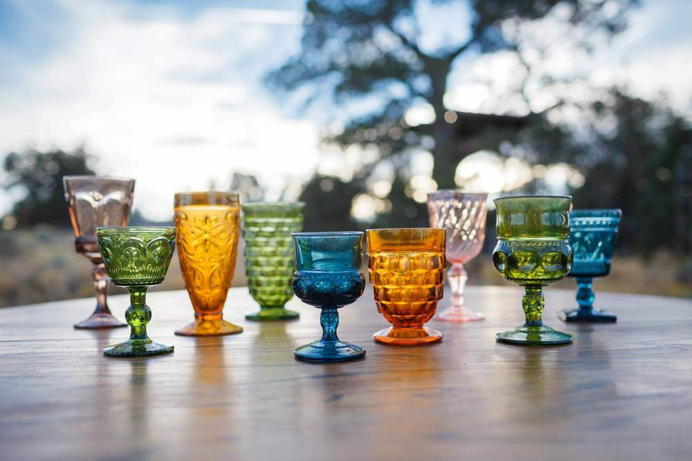 Pressed glass goblets assorted colors, shapes, and sizes.JPG