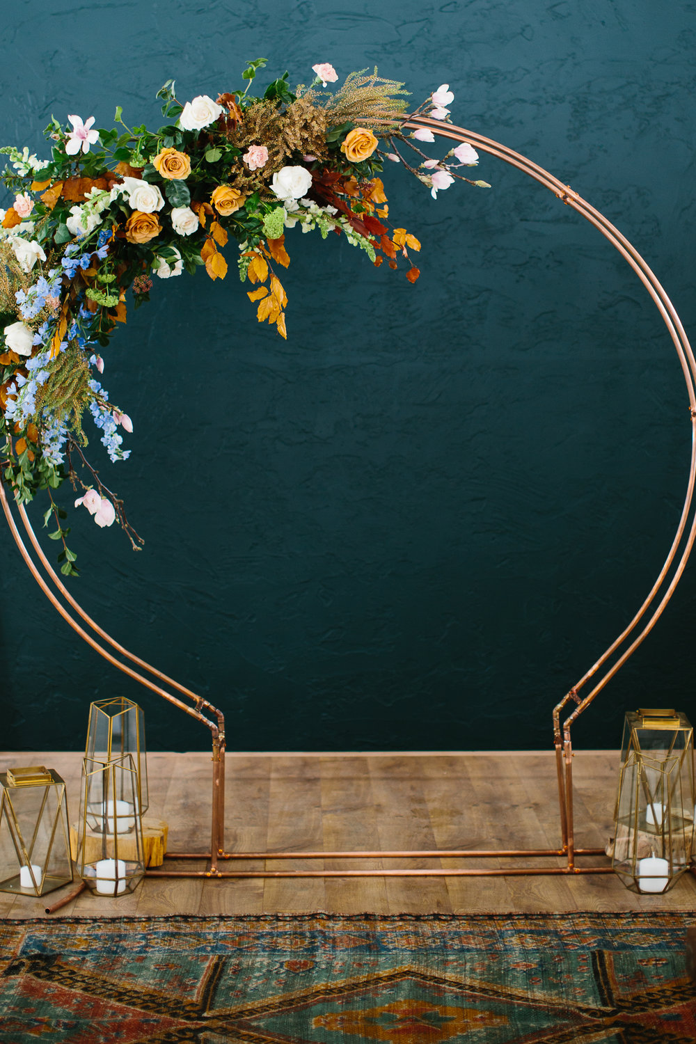 An ideal arbor and decor for a colorful wedding ceremony. Photo by  Lady J Memories , Florals  Hey You Flowers , venue  White Aspen Creative , arbor, decor and rug  Curated .