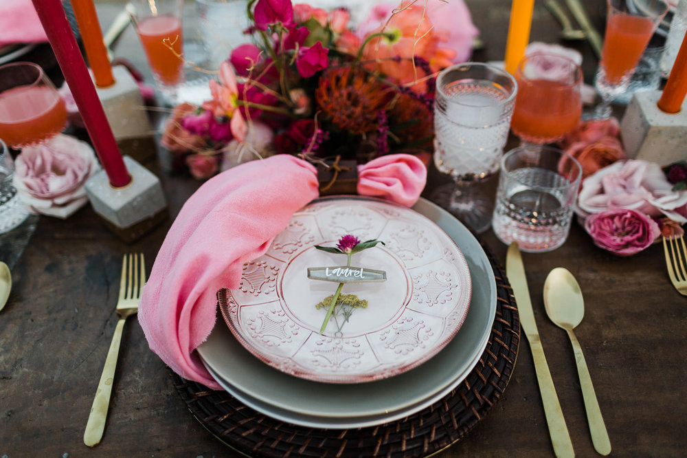 Stunning pops of coral for a little drama. Photo  Gallivan Photo , florals by  Summer Robbins Flowers , styling by  Swoon Event and Design , Lettering by  My Fair Letters , rentals by  Curated .