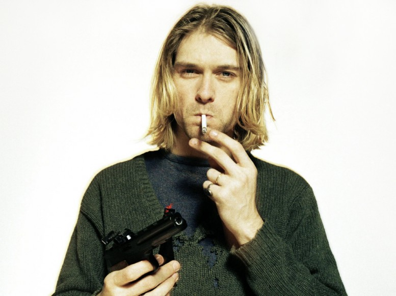 Kurt_Cobain_with_gun_experience_music