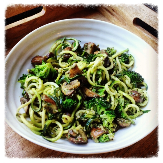 Bowl of healthy, courgetti gluten free pasta with homemade dairyfree pesto.