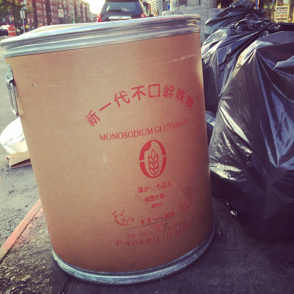 Photo of a large drum of MSG outside of a local restaurant in Williamsburg, Brooklyn. That's a lot of trash!