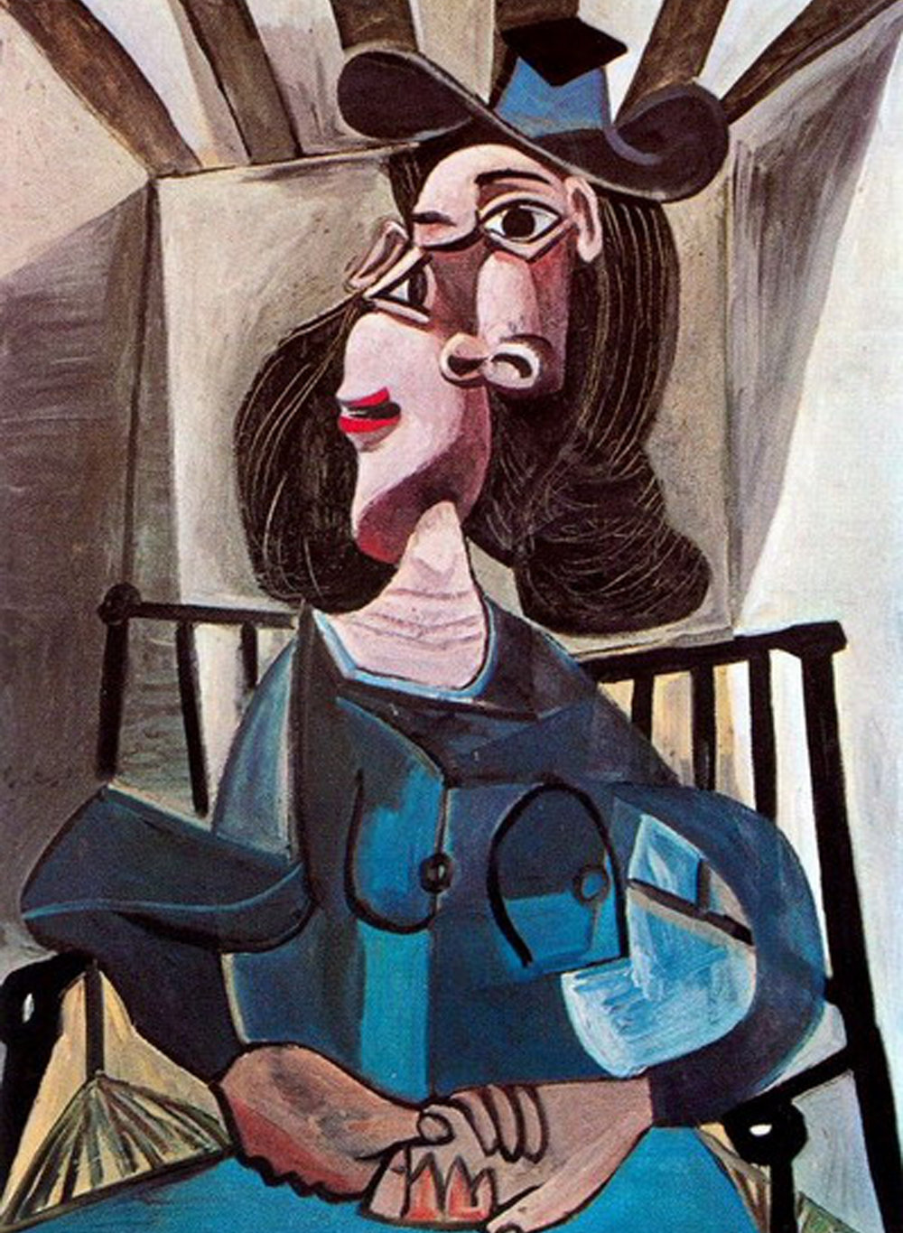 1941    Woman with a Hat Sitting in a Chair (Dora Maar)