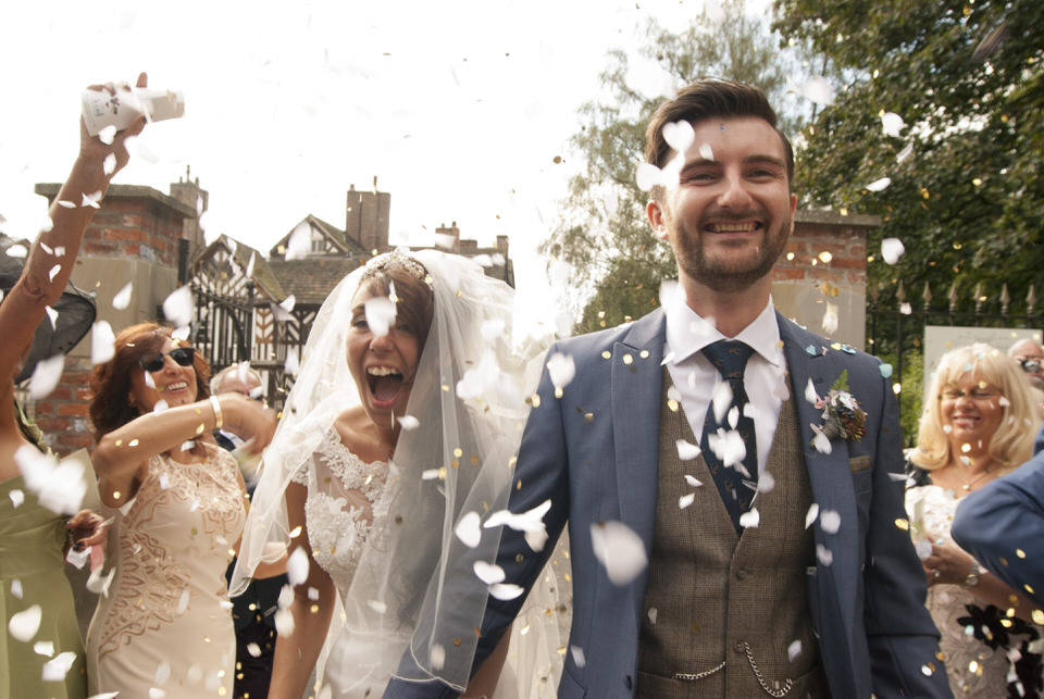 bride and groom are showered with confetti.JPG