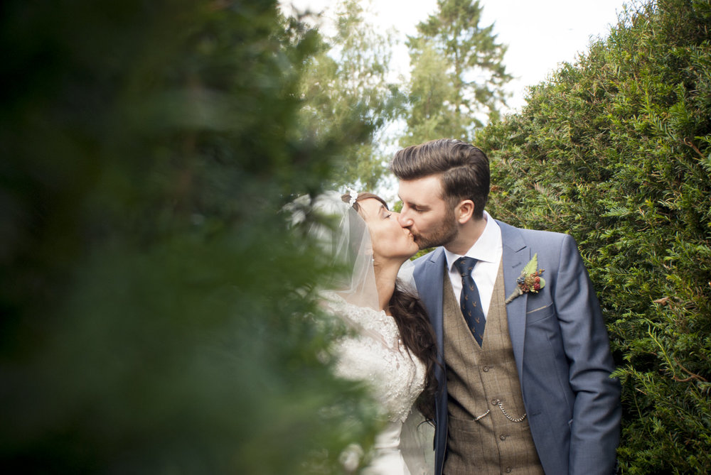 bride groom kissing in maze