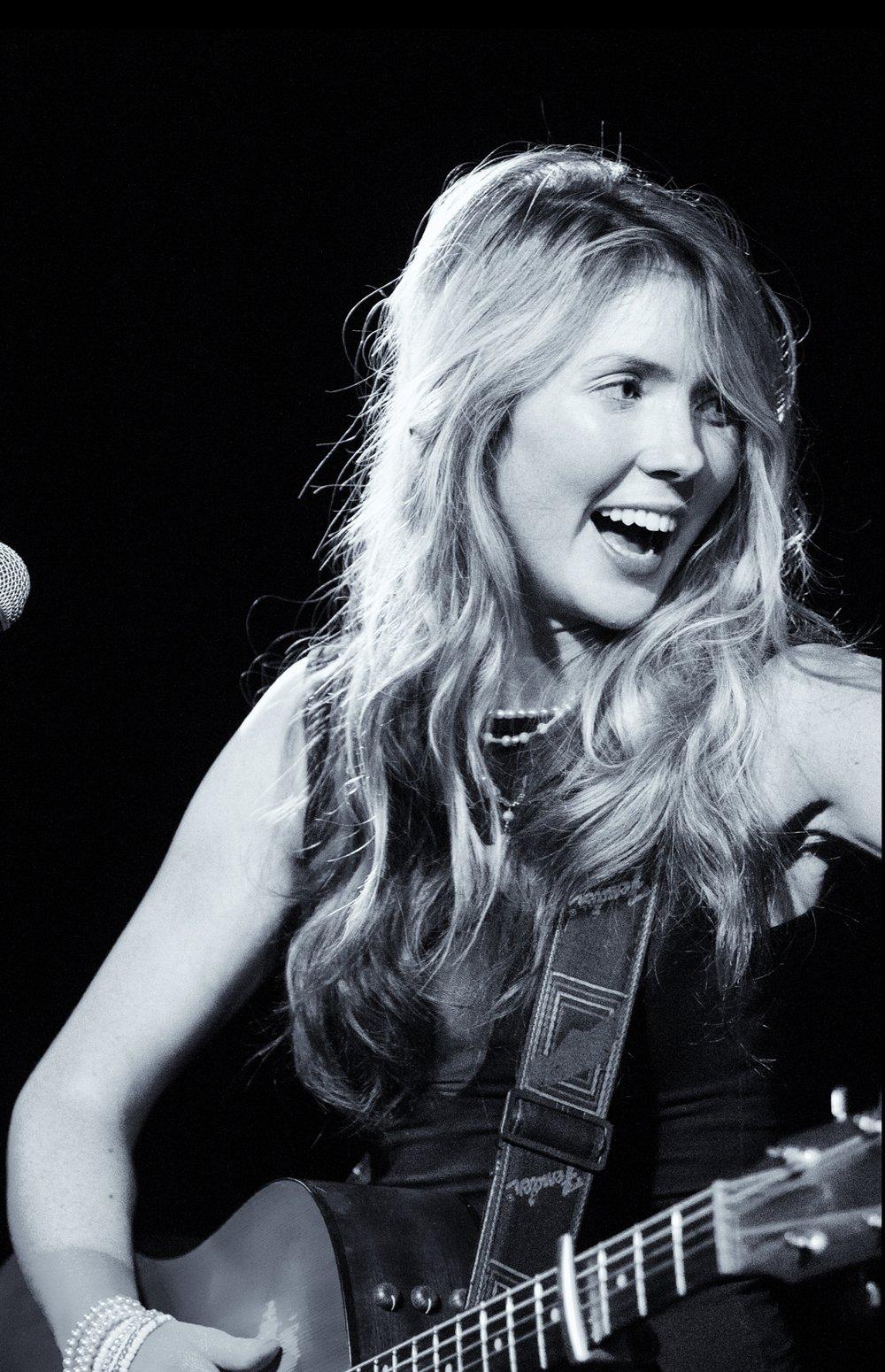 Beatie Wolfe on stage in Birmingham