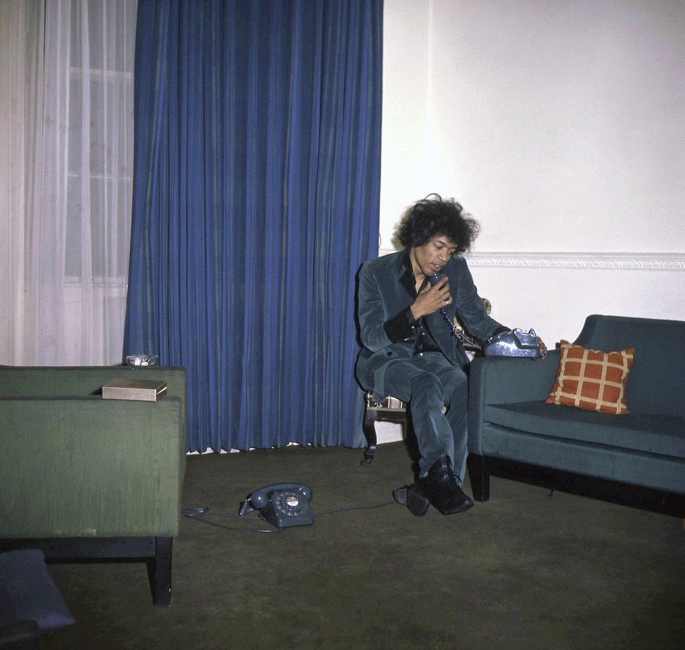 Jimi Hendrix inside on the phone in 34 Montagu Square - IMAGE - PETRA NIEMEIER - K & K - REDFERNS - GETTY IMAGES.jpg