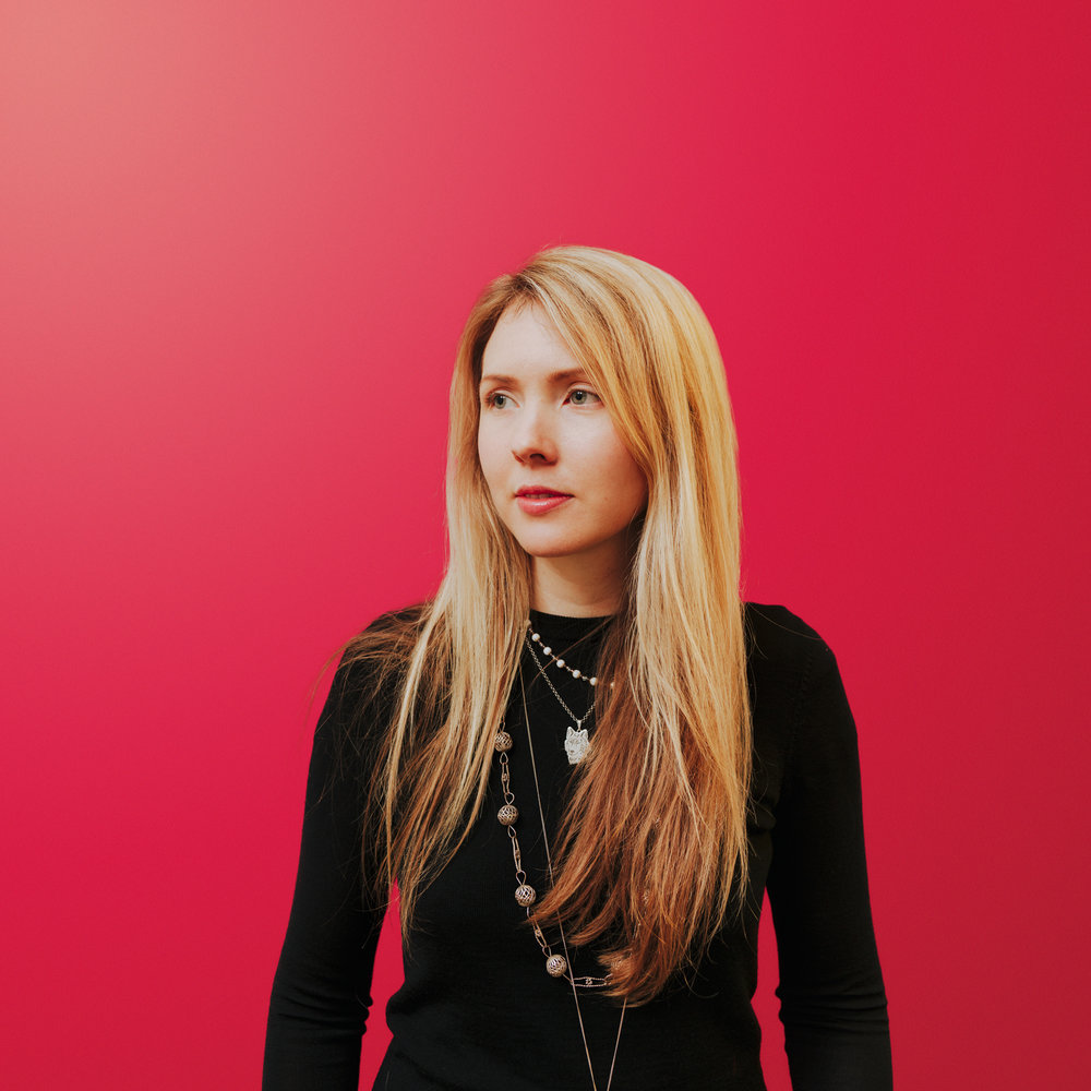Beatie Wolfe against red background with The Dots