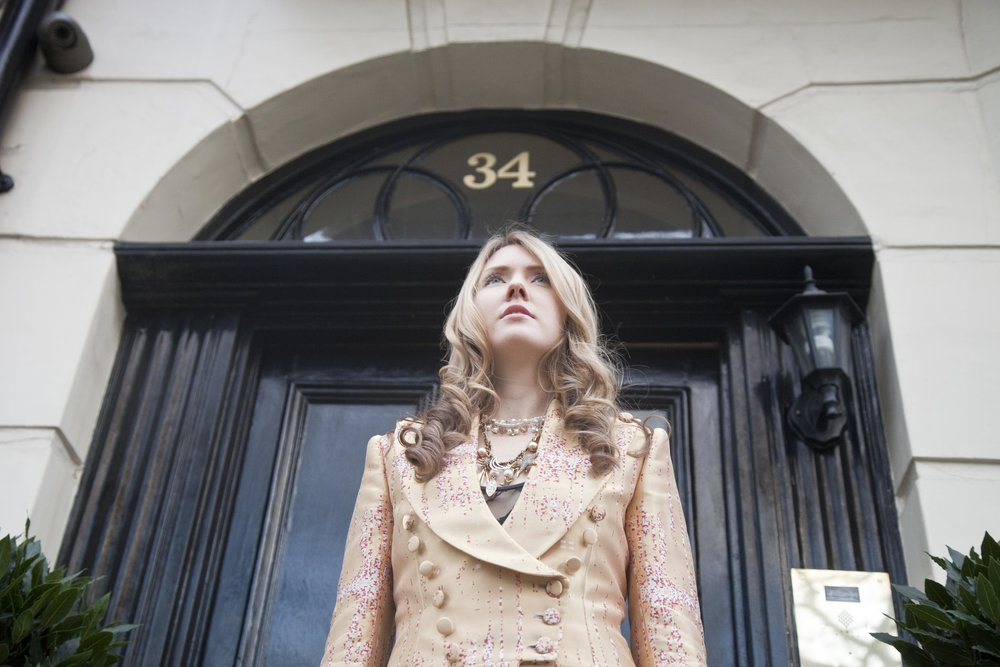 12. Beatie Wolfe in her Musical Jacket outside 34 Montagu Square 3 - Photo by Ollie Smallwood.jpg
