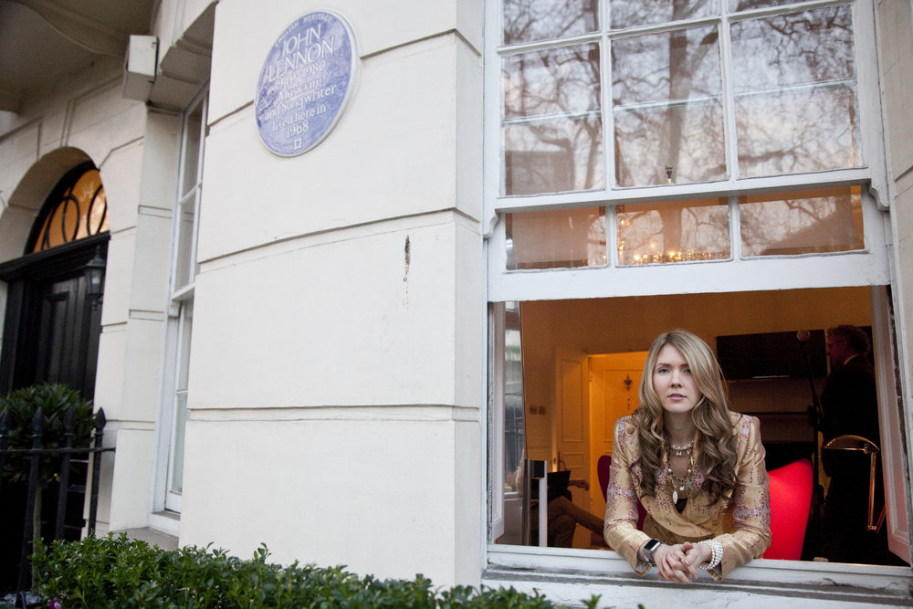 02. Beatie Wolfe in her Musical Jacket at window of 34 Montagu Square - Photo by Ollie Smallwood.jpg