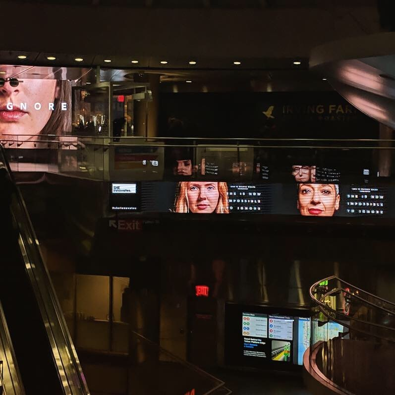 NYC Fulton Station main concourse ft Beatie Wolfe and co in UN campaign.jpg