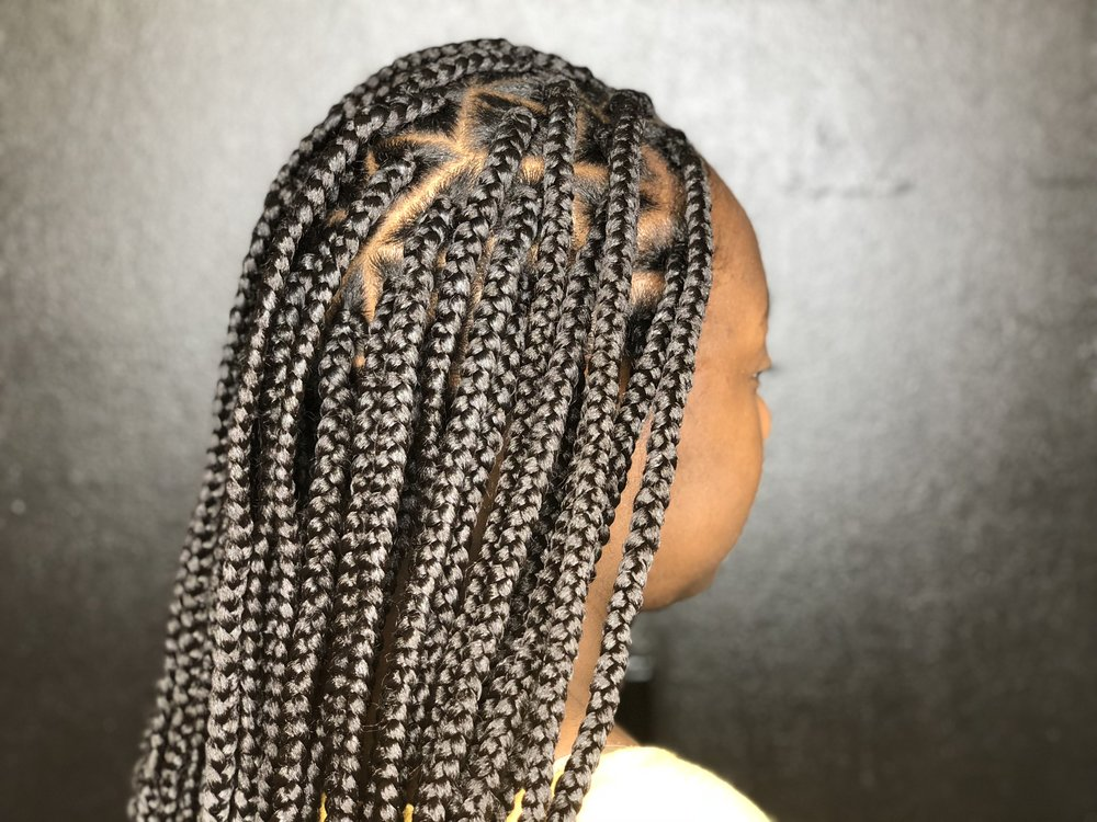 Medium box braids done by Skye of BOBH.