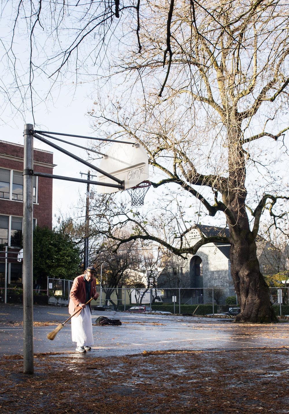 man_sweeping_basketball_court_web.jpg