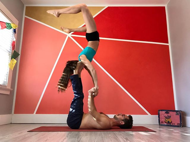 Goofing around with @flyinghapa celebrating my birthday and the first picture in front of our new wall! ✨ ✨ #acro #acroyoga #scorpionpose #sun #colors #red #firsthome #firsttimehomebuyer #yoga #birthday #birthdaycelebration #paintingwithatwist #yogamat #manduka