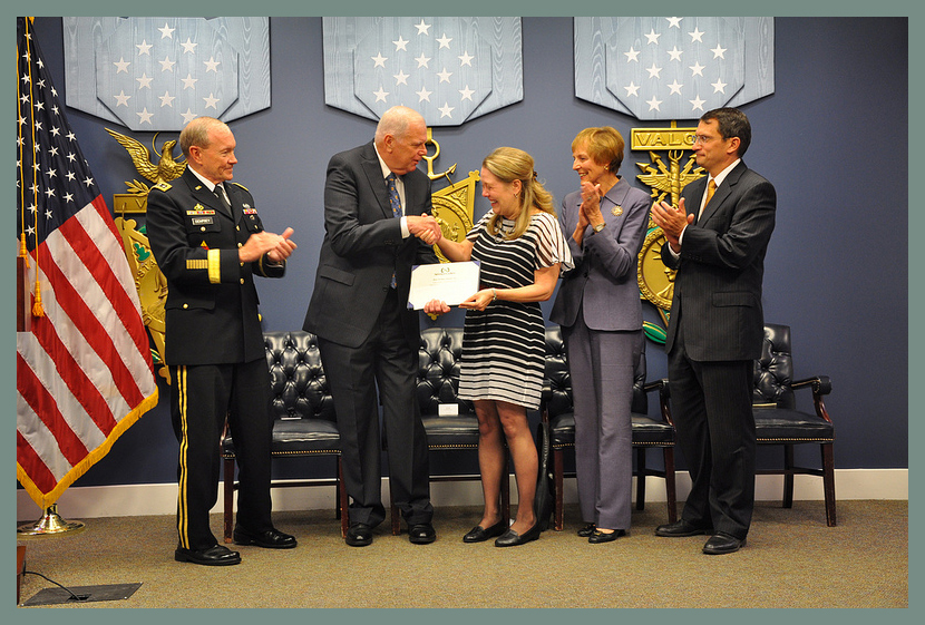BWB Executive Director Donna Musil receives Newman's Own Award for BWB and the Military Kid Art Project's Lora Beldon from Newman's Own President/COO Tom Indoe, accompanied by General Martin Dempsey, Chairman of the Joint Chiefs of Staff (L), Fisher House Trustee Mrs. Mary Jo Myers, and Military Times Editor-in-Chief Tobias Naegele.