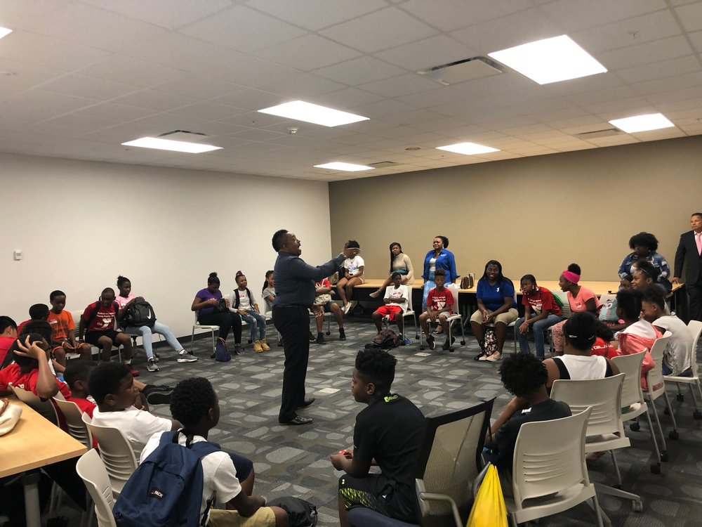 "David Massey, facilitating a ""Teen Talk,"" session on the campus of Atlanta Metropolitan campus"
