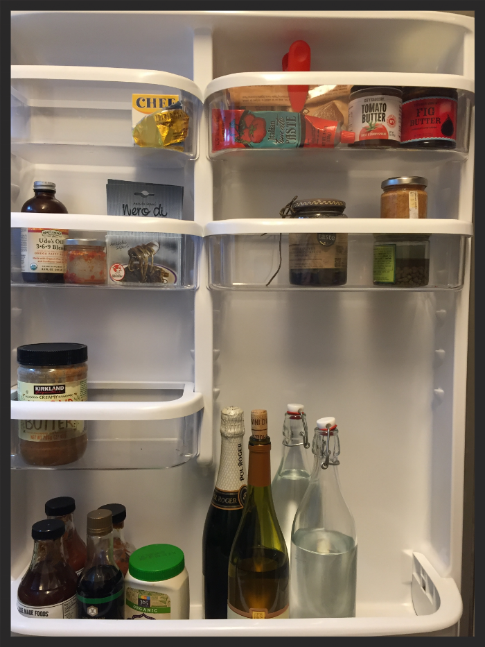 The fridge side door reorganized to hold less heat-sensitive foods