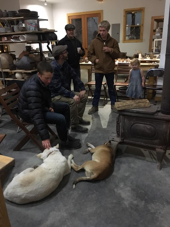 Guests staying warm during a rain storm during the studio sale