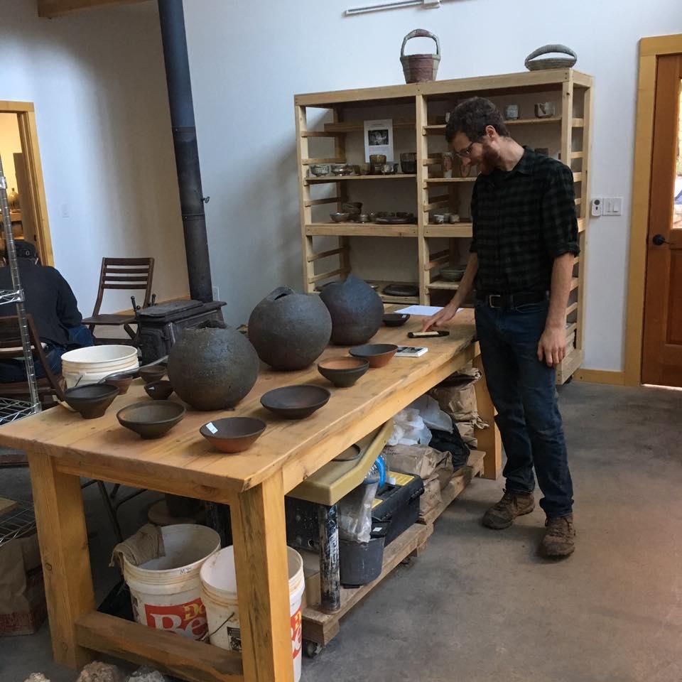Mitch Iburg arranging work for the studio sale
