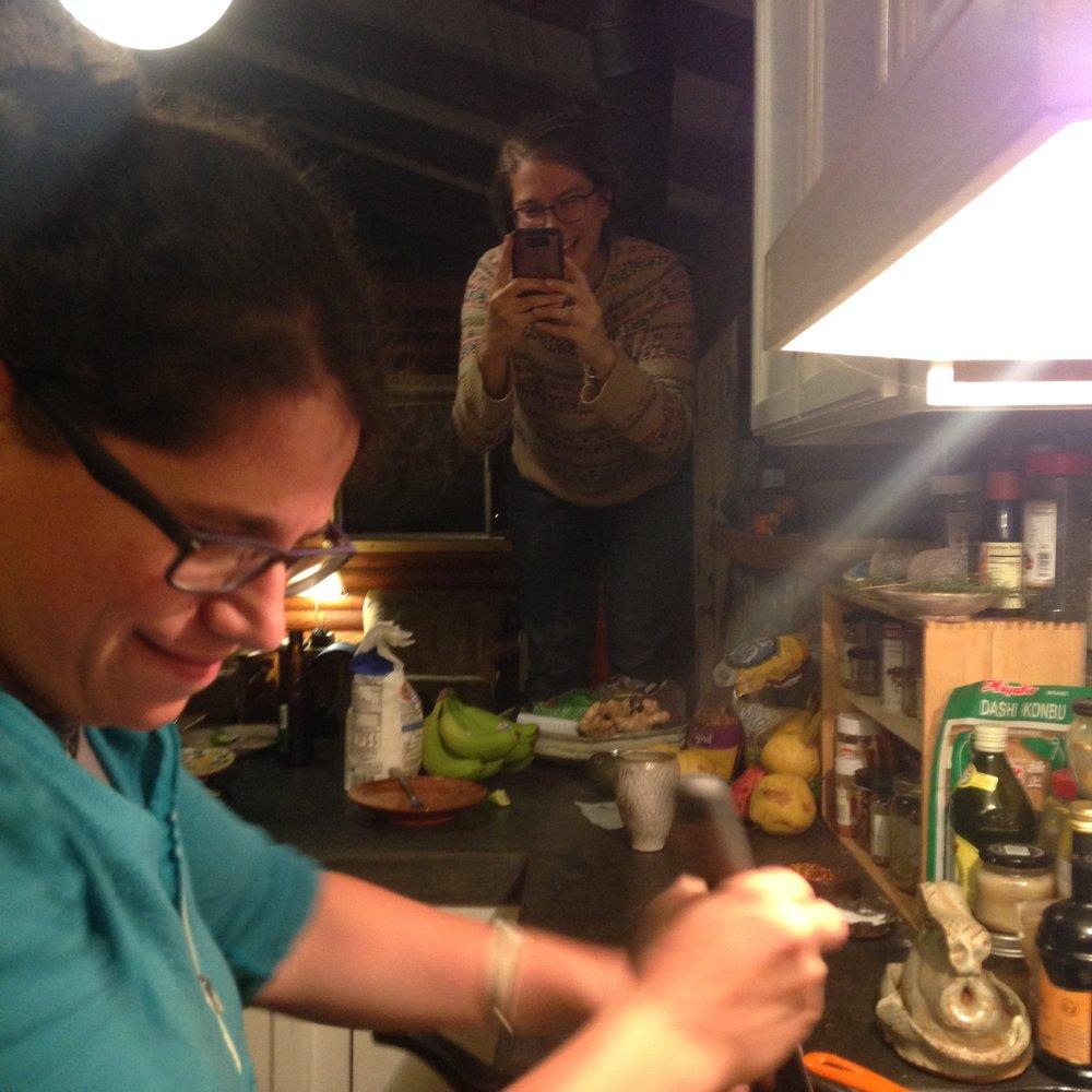 Resident Artists Jillian Blackwell and Shasta Krueger making papusas