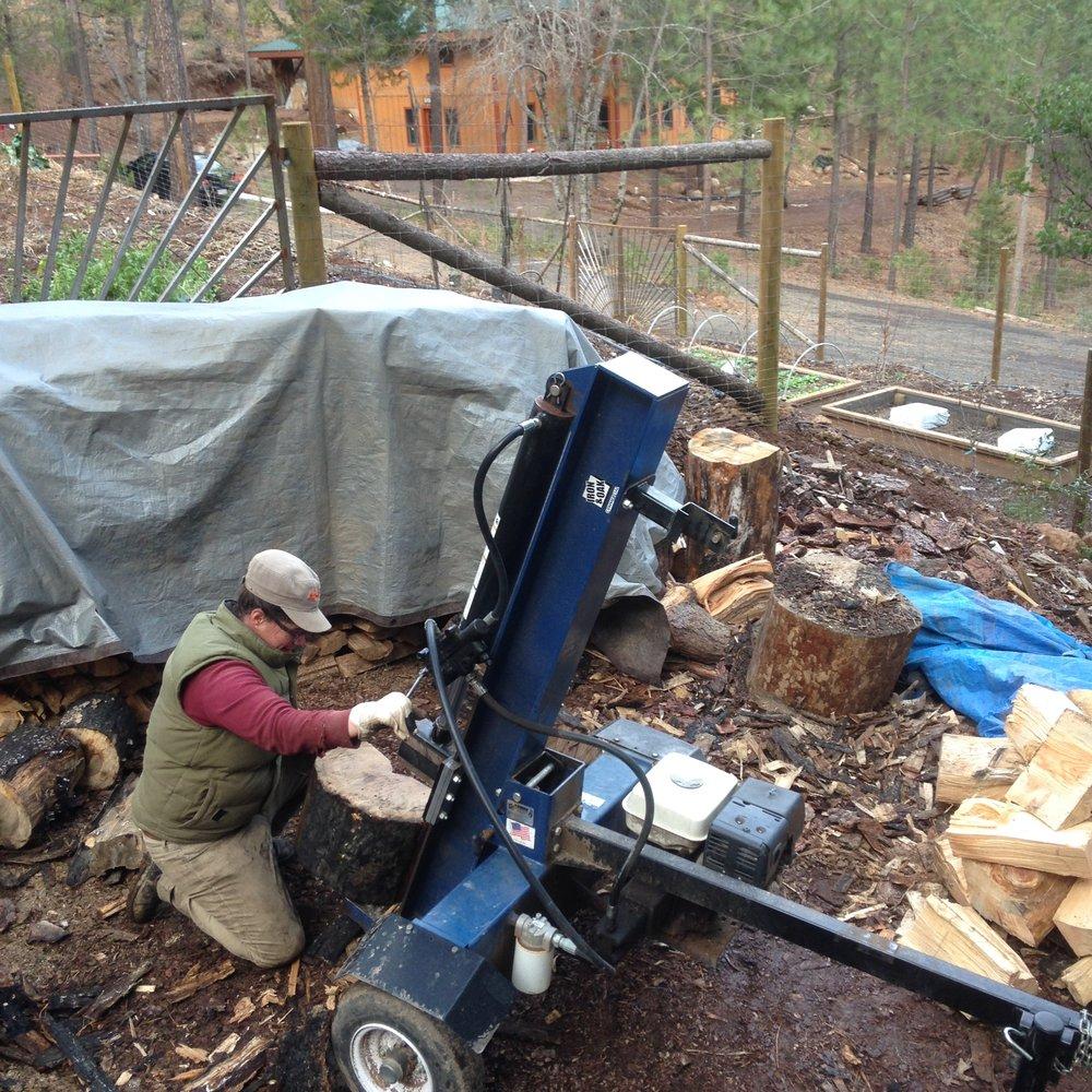 Shasta Krueger splitting wood.
