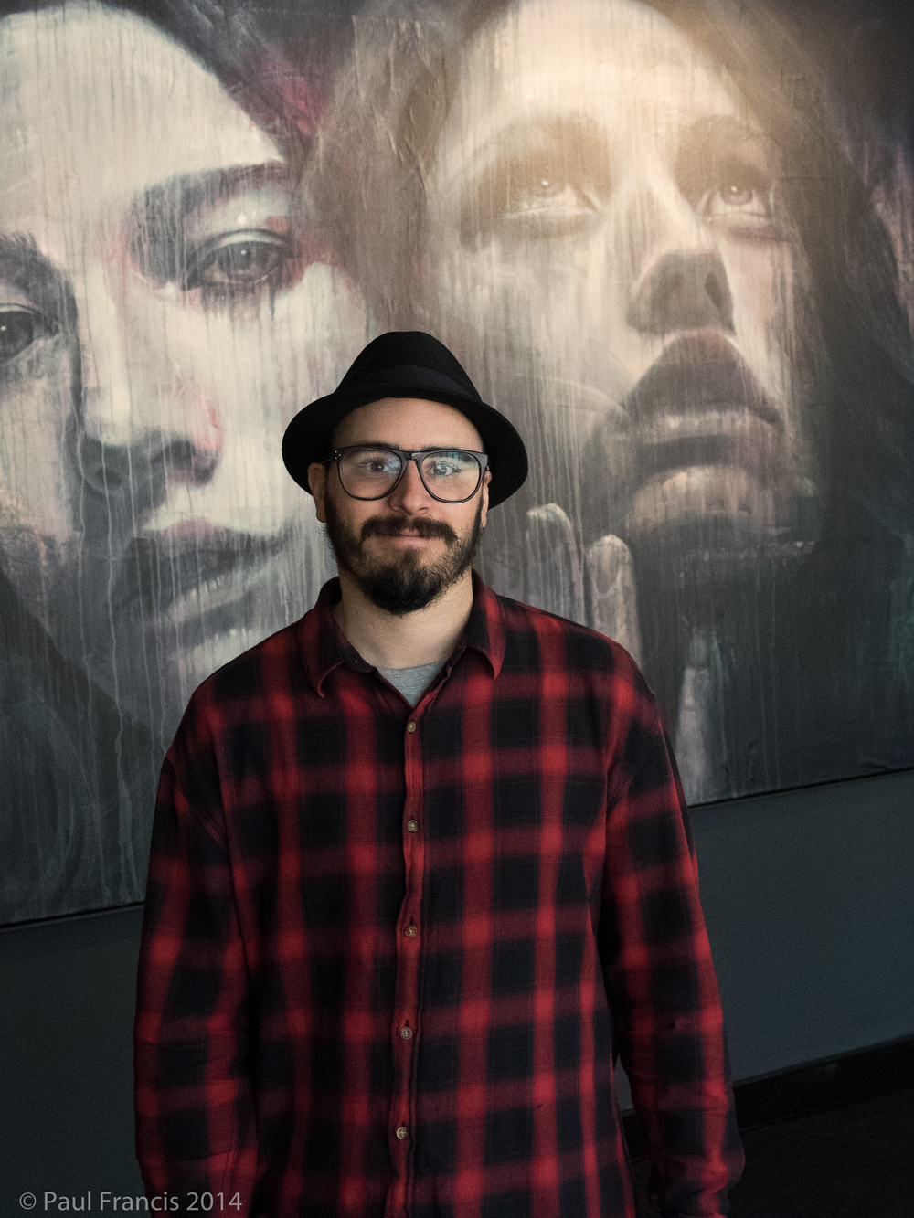 RONE in front of one of his exhibition pieces