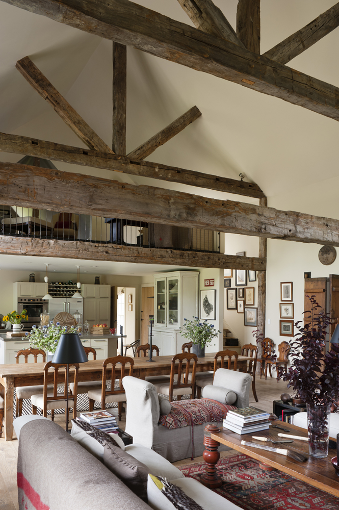 The home's interior, with Reclaimed Hand Hewn Beams by The Hudson Company.