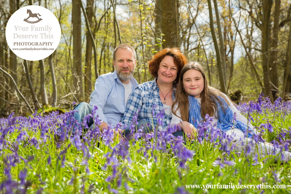 This family chose a shades of blue, complimented with white, for their Bluebell Photo shoot. This Outdoor Family Portrait was taken in the woods near The Vyne. Basingstoke Family Portrait Photographer.