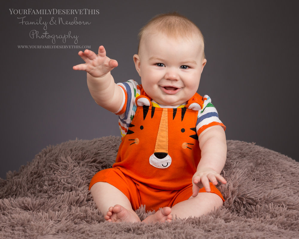 Riley's 6 month photoshoot, look how adorable he is. Give him a wave back! All about baby and their little personalities. www.yourfamilydeservethis.com